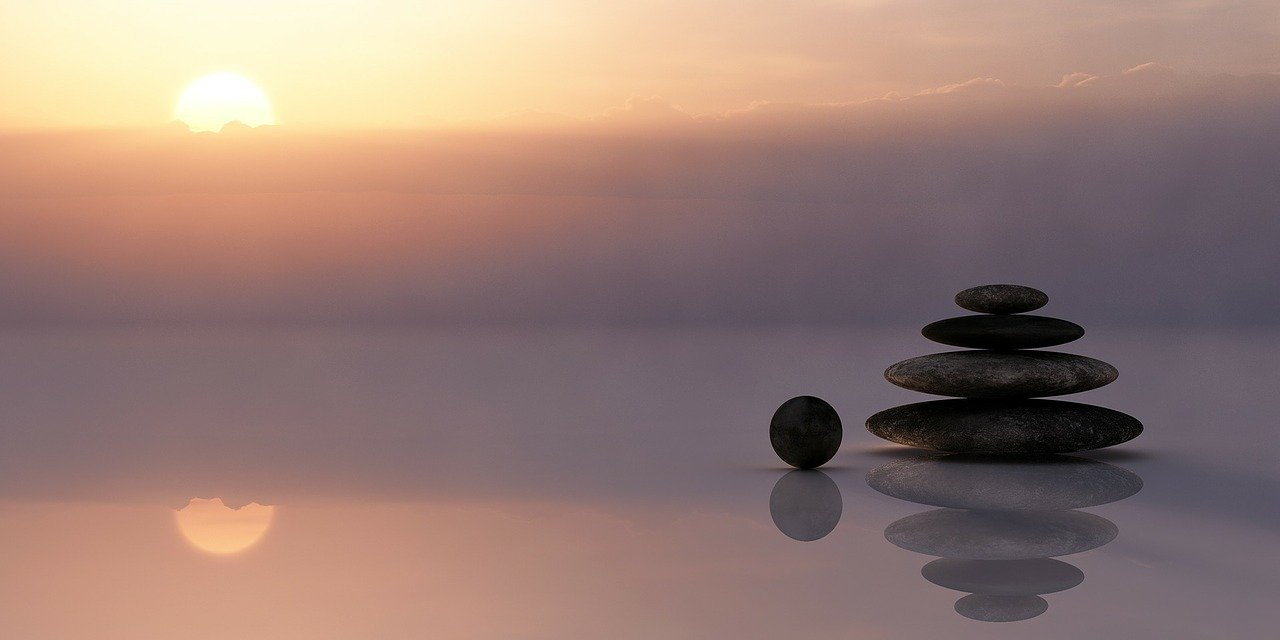 sunset balance pebbles